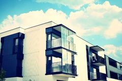 Modern apartment building exterior. Retro colors stylization stock photography
