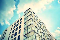 Modern apartment building exterior. Retro colors stylization stock photo