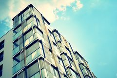 Modern apartment building exterior. Retro colors stylization royalty free stock images