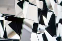 Abstract mirror. Close-up. Mirror with foursquare in wall, decoration and reflection. Abstract glass background. Polygonal surface. Close-up. Texture stock photography
