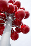 Abstract modern architectural element piece in form red berries. Red shiny plastic balls on the branches of the tubes in the form of berries placed in the trunk Royalty Free Stock Images