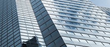 Office building facade under cloudy sky Royalty Free Stock Images