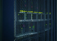 Abstract of modern high tech internet data center room with rows  racks  network and server hardware. Stock Photography