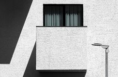 Abstract modern minimalist architecture with balcony. Window and street lamp. High contrast outdoor facade picture Stock Images