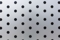 Black circles on a metal surface pattern texture background royalty free stock image