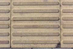 Concrete tile with stripes pattern texture background royalty free stock image