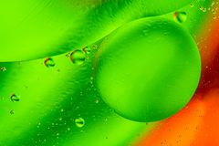 Abstract molecule sctructure or atom. Macro shot of air or molecule. Abstract green orange background. Space or planets abstract b. Abstract molecule sctructure Royalty Free Stock Photography
