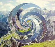 Collage with the landscape and the sacred geometry symbol spiral. Abstract mosaic collage with the image of the mountain landscape and the sacred geometry symbol royalty free stock image