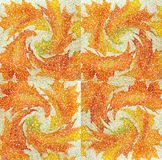 An abstract wallpaper pattern designed in warm autumn colors: bright orange, yellow, red and green colors Stock Photos