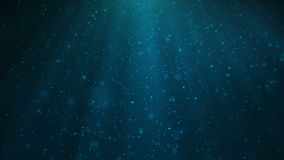 Abstract motion background of shining, sparkling blue particles. Beautiful blue floating dust particles with shine light