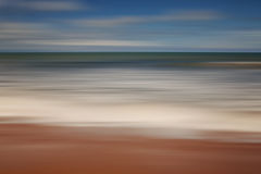 Abstract motion blur. At the beach, sea side & sky Stock Image