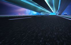 Abstract motion blur effect fast forward moving asphalt tunnel road.  royalty free stock photo