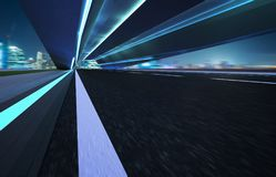 Abstract motion blur effect fast forward moving asphalt tunnel road.  Stock Images