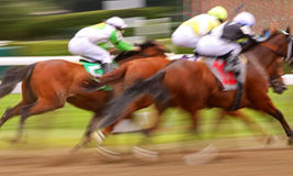 Abstract Motion Blur Horse Race. Slow shutter speed rendering of three jockeys racing their mounts to the finish line royalty free stock photo