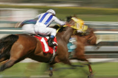 Abstract Motion Blur Horse Race. Slow shutter speed rendering of racing horses and jockeys stock images