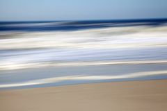 Abstract and Motion Blur Seascape blue, beige and white. Colors of Ocean and Beach Stock Photo