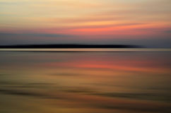 Abstract motion blur sunset. Nature background on the sea Stock Images