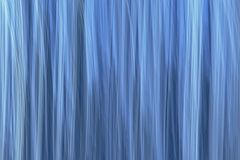 Abstract motion blurred blue background. Abstract motion blurred light blue reed background texture royalty free stock photos