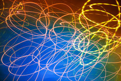 Abstract motion blurred lights on blue royalty free stock photography