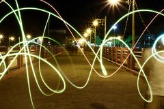 Abstract motion blurred lights on night city background. Stock Photos