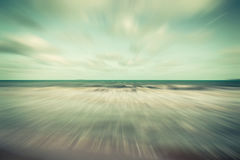 Abstract motion blurred sea and blue sky clouds vintage