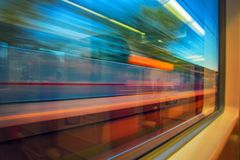 Abstract motion-blurred view from fast moving high speed train. Motion blur view from the window train. Concept traveling by rail stock photos