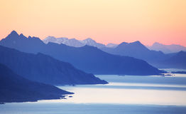 Abstract mountain sunset with ocean.  Royalty Free Stock Images