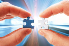 Abstract moving background hand with puzzle Stock Photo