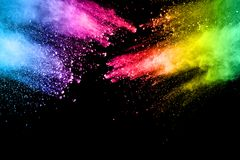 Abstract multi color powder explosion on black background. Freeze motion of color dust  particles splash. Painted Holi in festival Stock Image