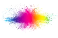 Abstract multi color powder explosion on white background. Freeze motion of color dust particles splash. Painted Holi in festival stock image