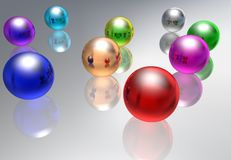 Abstract multi-coloured glass spheres. On a reflecting background Stock Photography