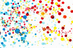 Abstract multicolor background. Bubbles of paint and ink on a white, pattern of drop. Royalty Free Stock Photography