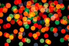 Abstract multicolor bokeh texture on black background. Defocused sparkles stock photo