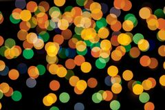 Abstract multicolor bokeh texture on black background. stock photos
