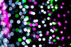 Abstract of multicolored circular bokeh. Photo abstract of multicolored circular bokeh background at night of Christmaslight stock photo