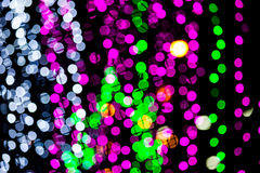 Abstract of multicolored circular bokeh. Photo abstract of multicolored circular bokeh background at night of Christmaslight royalty free stock photography