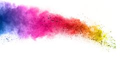 Abstract multicolored dust explosion on white background. Abstract color powder splattered on background Royalty Free Stock Photos