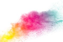 Abstract multicolored dust explosion on white background. Abstract color powder splattered  on background Royalty Free Stock Images