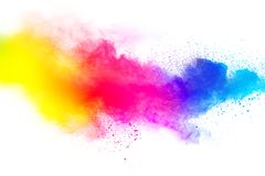 Abstract multicolored dust splatter on white background. Freeze motion of color powder explosion on white background stock photo