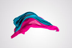 Abstract multicolored fabric in motion. Abstract pieces of fabric flying, high-speed studio shot Royalty Free Stock Photos