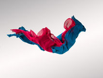 Abstract multicolored fabric in motion. Abstract pieces of fabric flying, high-speed studio shot Stock Image