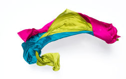 Abstract multicolored fabric in motion. Abstract pieces of fabric flying, high-speed studio shot Stock Images