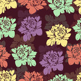 Abstract multicolored flowers seamless pattern. Vintage floral background. Multicolor buds on a burgundy . For the fabric design, Stock Photography