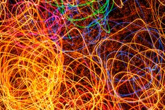 Abstract Multicolored Glowing Shapes as Background. Abstract multicolored glowing shapes as a background (long exposure shot Royalty Free Stock Image