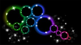 Abstract multicolored luminous rings on a black background. EPS 10. Multicolored glowing rings with sparkles on a black background Stock Photography