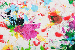 Abstract multicolored paints fabric background. Stock Photo