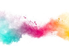 Abstract multicolored powder explosion on white background.Colorful dust explode. Painted Holi powder festival.  royalty free stock images