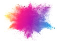 Abstract multicolored powder splatted on white background. Freeze motion of color powder explosion Royalty Free Stock Photo