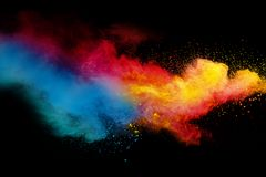 Abstract multicolored powder splatter on black background. Freeze motion of color powder splash. Color dust explosion on background royalty free stock photos