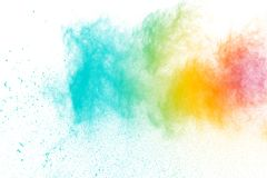 Abstract multicolored powder splatter. On white background. Freeze motion of color powder splash. Color dust explosion on background Stock Image